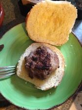 Put the burger on the garlic bread bun